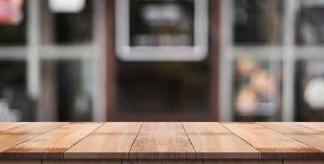 Obraz Empty Wood Table With Blur Vintage Restaurant Background. - fototapety do salonu