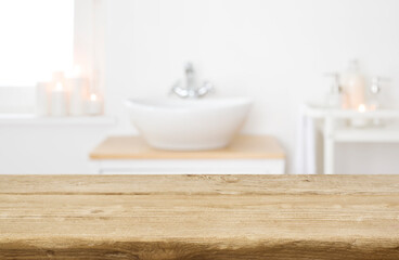 Table board before heavily blurred spa salon bathroom shelves background
