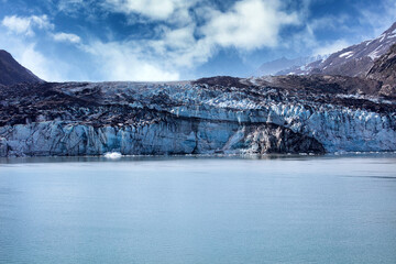 Alaska Glacier entering water with global warming and climate change melting the glaciers concept