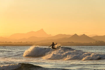 Surfing at sunset, Byron Bay Australia