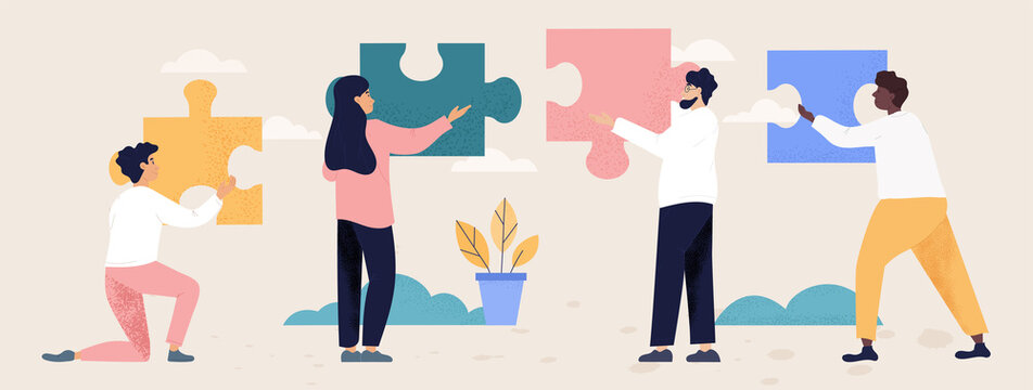 Teamwork and collaboration concept with people with puzzle pieces