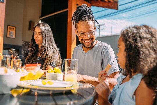 Happy latinx family having breakfast at home