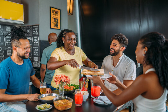 Happy latinx family having barbecue party in home