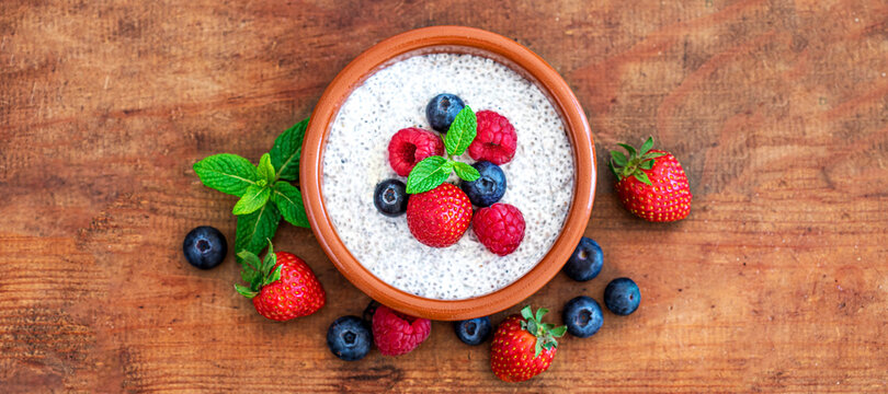 Chia seed pudding made with fresh berries on wooden table.  Chia seeds Yogurt. Top view. Copyspace.