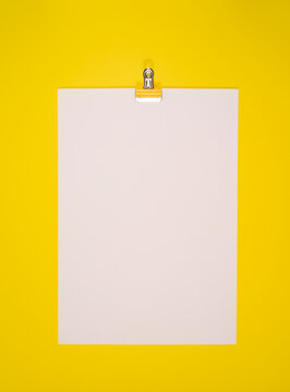 Blank white paper space for text on a yellow bright background
