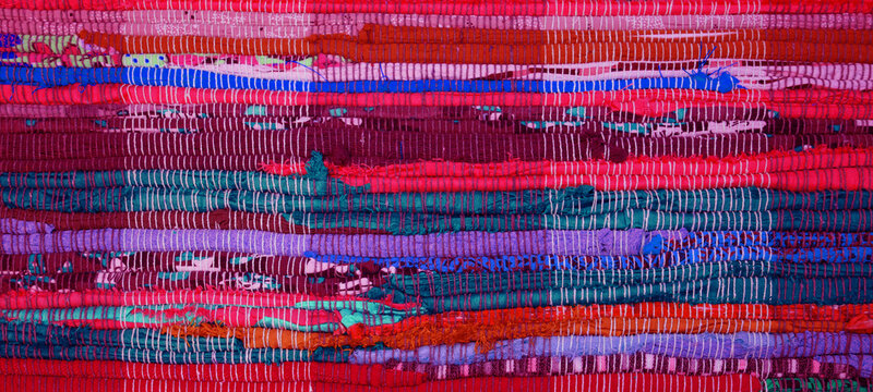 Top view of colorful handmade Chindi rag vintage carpet reversible runner cotton woven floor rug textile fabric texture