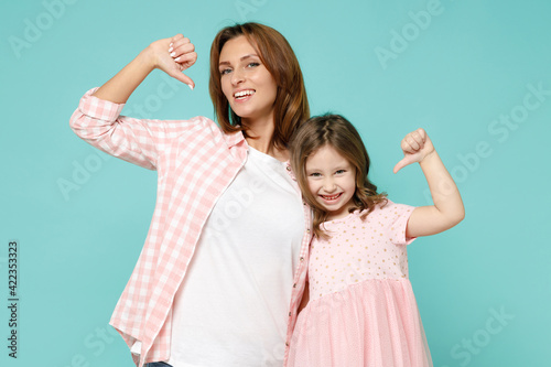 Happy woman in pink clothes have fun with child baby girl 5-6 years old Mommy little kid daughter motivating encourage isolated on pastel blue azure background studio Mother's Day love family concept