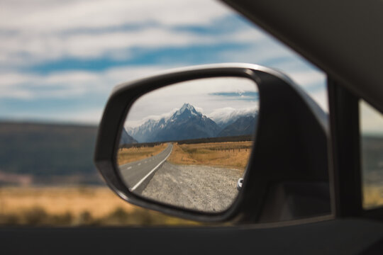view of mount cook new zealand in the rear view mirror. end of journey. traveling is over
