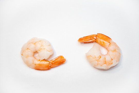 Closeup shot of two shrimps on a white background