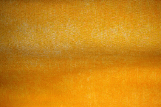 close-up on yellow cotton and polyester fabric cloth