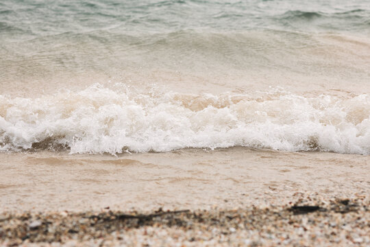Sea waves on the sandy beach natural. Concept of feeling relaxing on the beach.