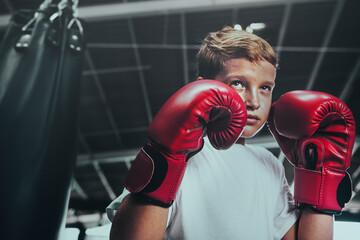 Fototapeta Young man getting ready for boxing obraz