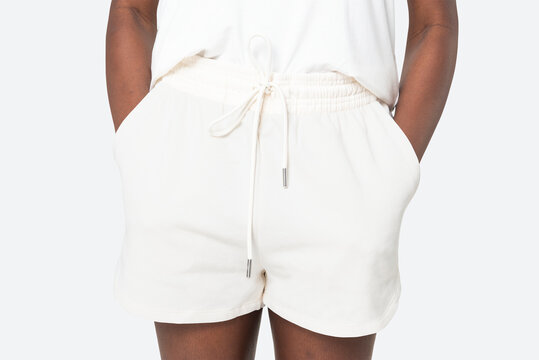 Woman in white shorts summer fashion photoshoot close up