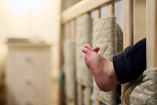 Barefoot baby body part.