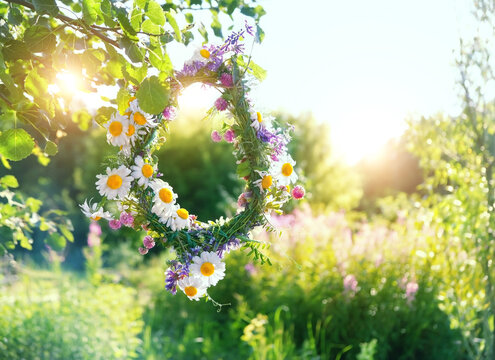 rustic wildflowers wreath on sunny meadow. Summer Solstice Day, Midsummer concept. floral traditional decor. pagan witch traditions, wiccan symbol and rituals