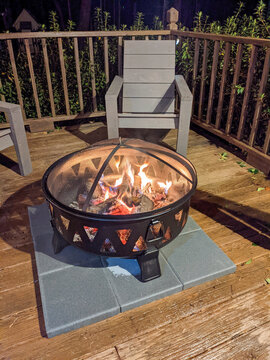 New modern home features a backyard with fire pit