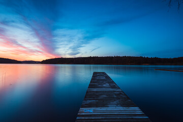 Wooden jetty at lake during sunrise