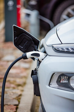 EV Car or Electric car at charging station with the power cable supply plugged in