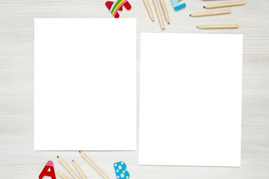 2 empty paper sheets, coloring pages, kids worksheet mockup, pencils and colorful letters.