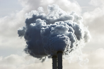 Obraz Smoking chimney pipes of a electro power station plant  causing air pollution. - fototapety do salonu