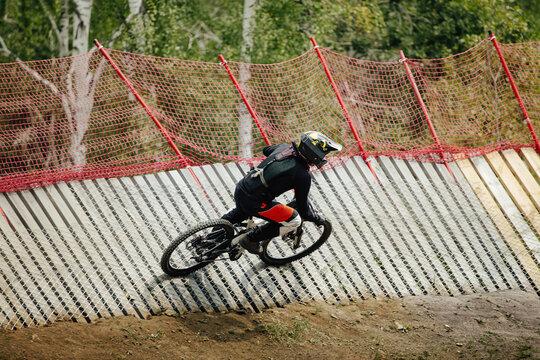 athlete rider downhill wallride turn in forest