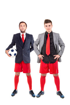 Happy businessmen with football