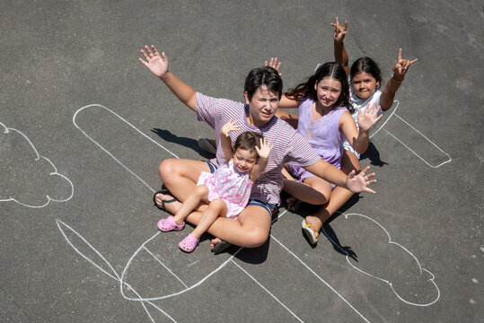Children playing in a chalk airplane