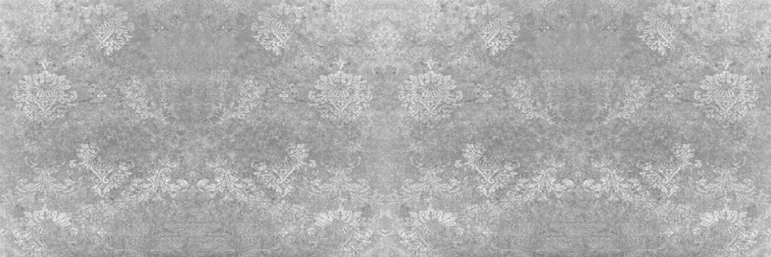 Seamless abstract mosaic grey gray white concrete stone cement wall texture, with ornate flower leaf pattern print tile wallpaper wide background panorama