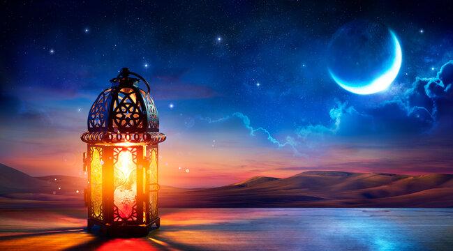 Muslim Holy Month Ramadan Kareem - Ornamental Arabic Lantern With Burning Candle Glowing At Evening - Eid Al Fitr