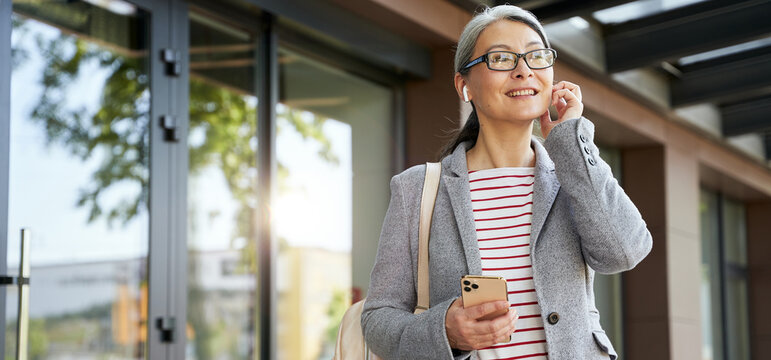 Radiant middle-aged woman enjoying a walk outside