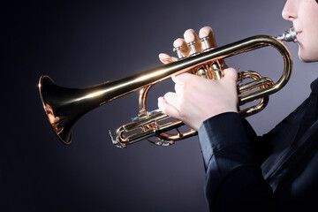 Trumpet player playing jazz music instrument. Brass Trumpeter hands closeup
