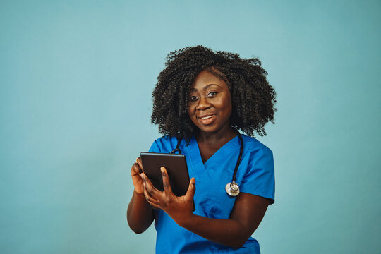 Nurse practitioner doctor with tablet and stethoscope
