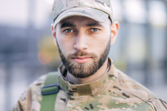 Portrait of a sad desperate young military man, looking pensivel