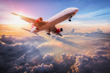 Landscape with aircraft is flying above clouds in the blue sky. Travel background with passenger plane. Commercial airplane. Private jet. Fast Travel and transportation concept