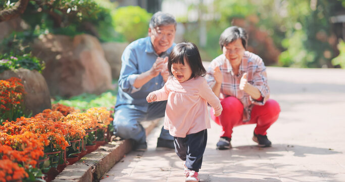 couple play with granddaughter