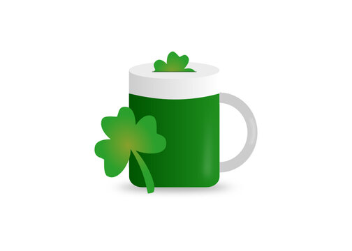 Green beer glass with clover leaf on white background. St patricks day concept.