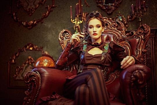 woman sits holding cigar
