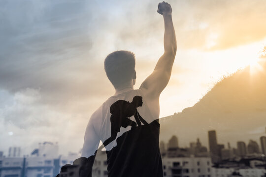 Strong man reaching the top of mountain never giving up. Overcoming life challenges, and setting goals concept.