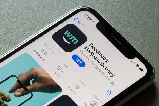 Portland, OR, USA - Mar 24, 2021: Weedmaps: Marijuana Delivery and Cannabis app is seen in App Store on an iPhone. The app lets users explore cannabis products, find nearby dispensaries and doctors.