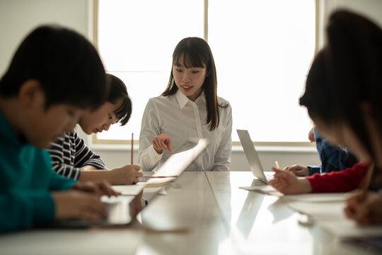 ICT in Education - Female Teacher Facilitating