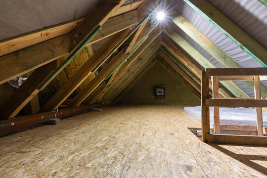 The attic of a single family house with a wooden floor