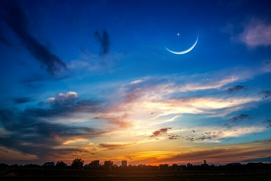 Crescent moon with beautiful sunset background