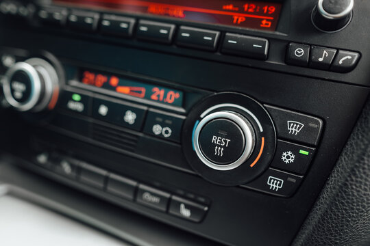 Car climate control panel with air conditioning on. The air conditioning system is ready for high summer temperatures