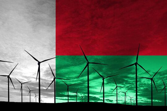 Madagascar flag wind farm at sunset, sustainable development, renewable energy