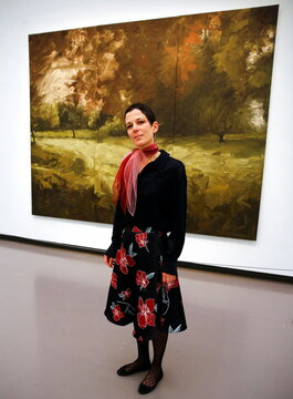 """Curator Hug poses in front of the painting """"Parkstueck"""" by German painter Gerhard Richter at the Kunsthaus Zurich art museum in Zurich"""