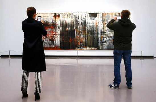 """People take pictures of the painting """"St. Gallen"""" by German painter Gerhard Richter at the Kunsthaus Zurich art museum in Zurich"""