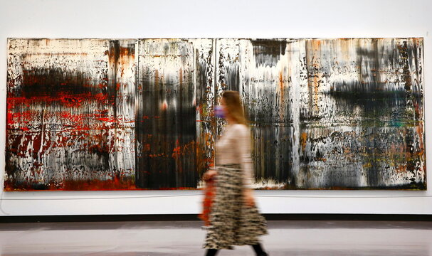 "A woman walks past the painting ""St. Gallen"" by German painter Gerhard Richter at the Kunsthaus Zurich art museum in Zurich"