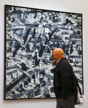 """A man looks at the painting """"Stadtbild D"""" by German painter Gerhard Richter at the Kunsthaus Zurich art museum in Zurich"""