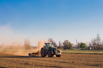 Tractor working in the field, preparing the land for planting
