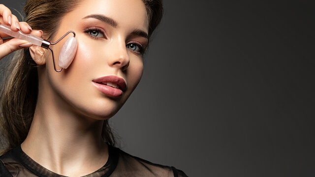 Beautiful face of young caucasian woman with perfect healthy skin, isolated. Pretty white model caring of face. Beauty treatment concept. Skin care concept..